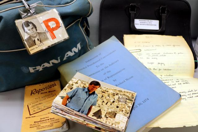 A selection of items from the Papers of Tom Brokaw, including a Pan Am flight bag filled with press passes to historic events, a reporter's notebook, and candid snapshots from NBC News productions, among other items.