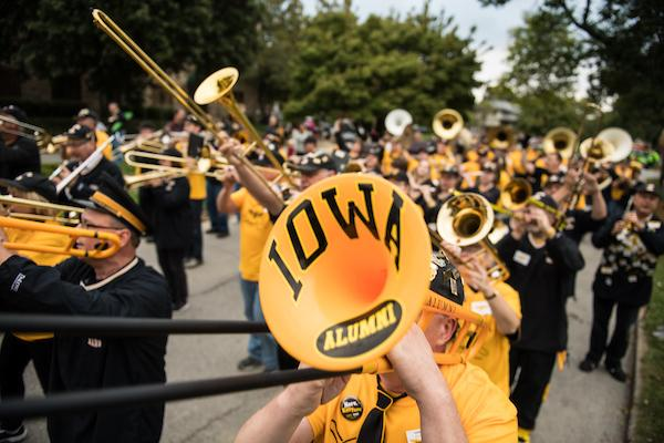 A UI alumnus trombonist plays in the 2016 Homecoming Parade.
