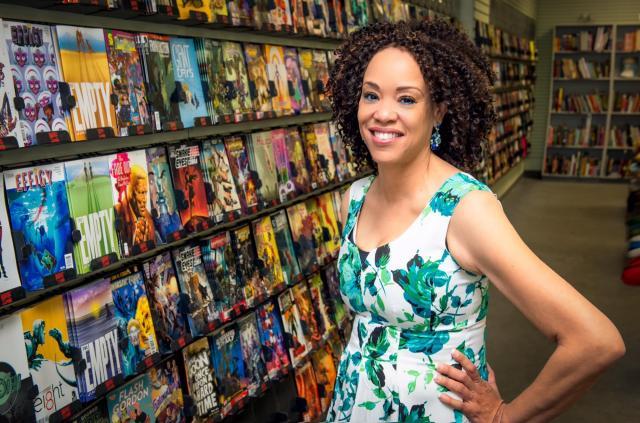 Portrait of Deborah Whaley in comic store