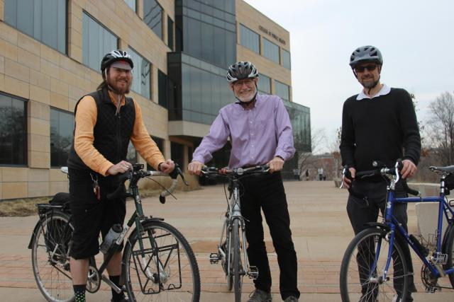 UI College of Public Heath professor Peter Thorne, center, nominated Ruxton Smith, left, and Ryan Carnahan, right, as Wellness Heroes for their commitment to biking to work every day.