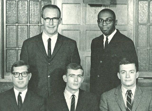Black-and-white image of men posing for yearbook photo