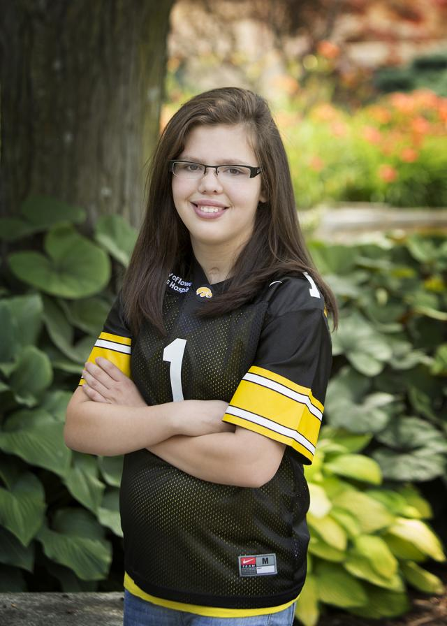 teenage girl wearing hawkeye jersey