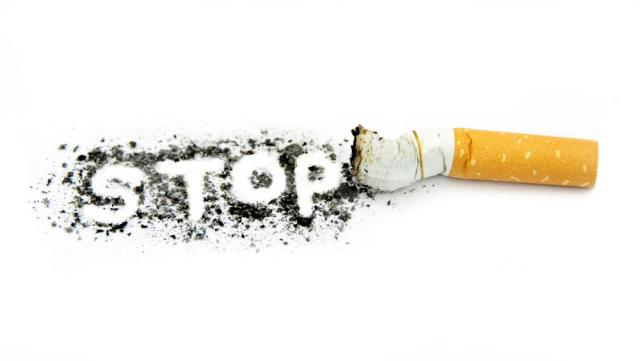 "photo illustration of a scrunched cigarette with the word ""STOP"" in ashes next to it"