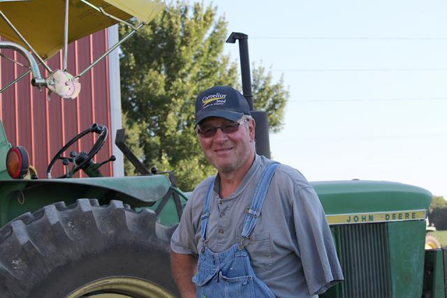 brian egel standing near tractor
