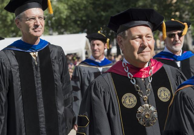 UI Provost P. Barry Butler and President Bruce Harreld walk to the stage at Convocation.