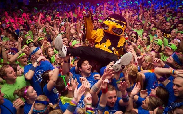 Herky body surfs above the crowd at Dance Marathon 20.