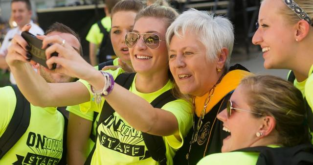 President Mason takes a selfie with UI students.