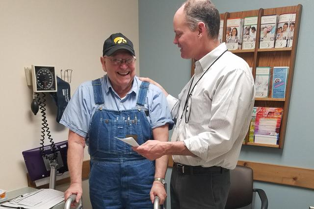 Jim Hoehns assisting a patient in the Northeast Iowa Family Practice Center