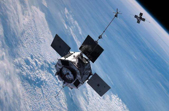 artist's rendering shows the twin RBSP satellites in tandem orbit above the Earth