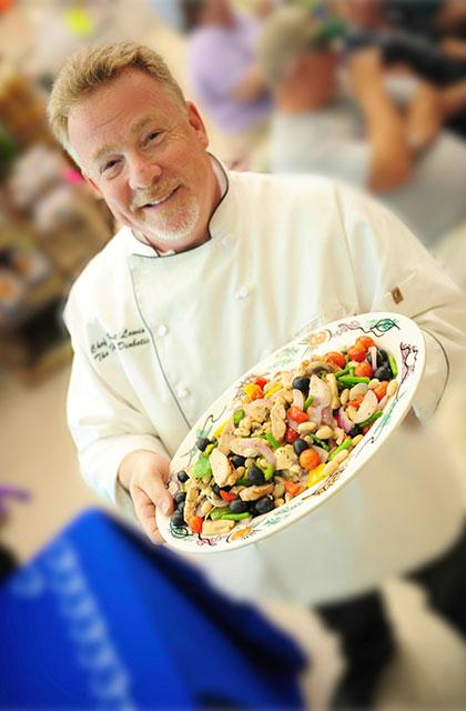 Chef Robert Lewis holding a platter of veggetables