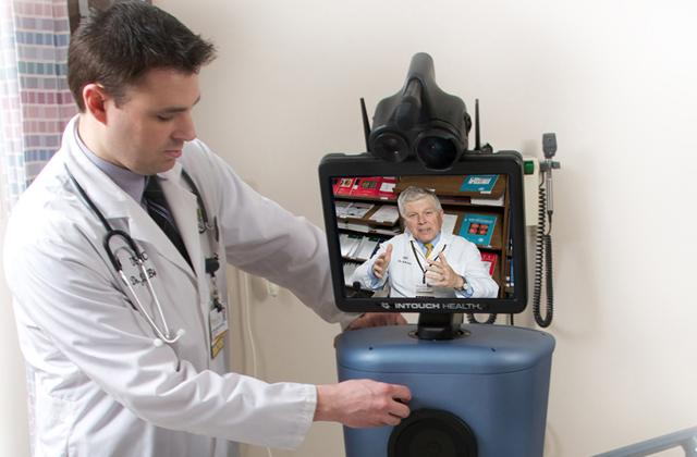 doctor using stroke robot to communicate with off-site patient