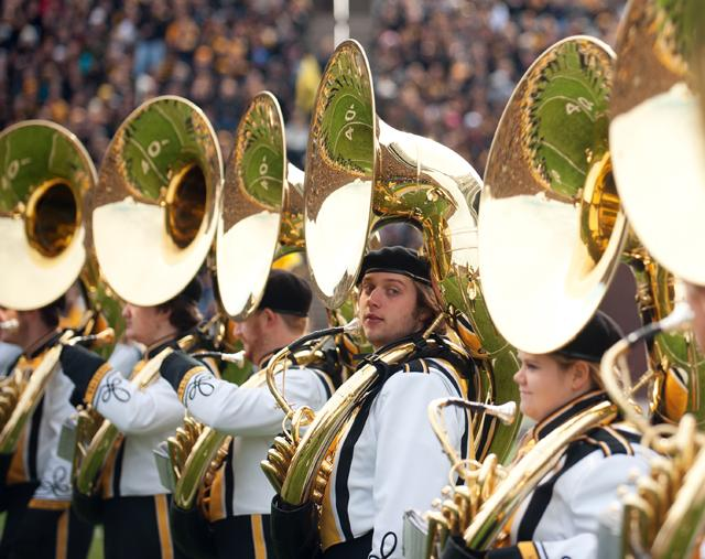 hawkeye marching band members holding instruments