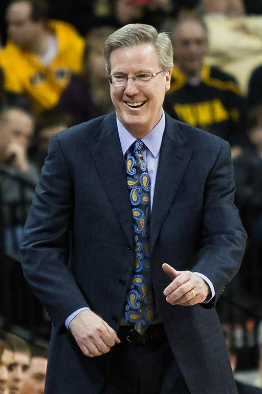 Fran McCaffery smiling on the sidelines