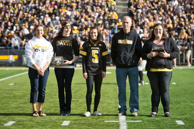 Rich and Patti Schmitz, of Waterloo, are recognized as Dad and Mom of the Year at half-time of the Nov. 10 Iowa football game