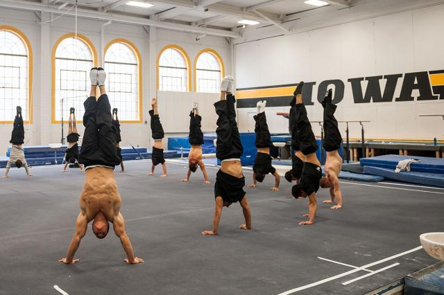 Iowa gymnasts doing hand stands