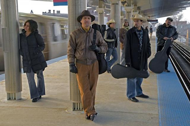 Sons of Mexico band members on train platform