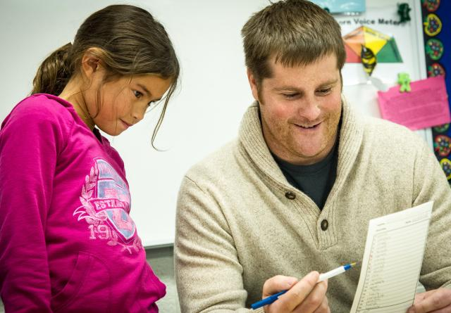 Teacher Ted Proctor leads a student to take ownership of her learning