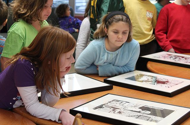 students look at comics and graphic novels collection