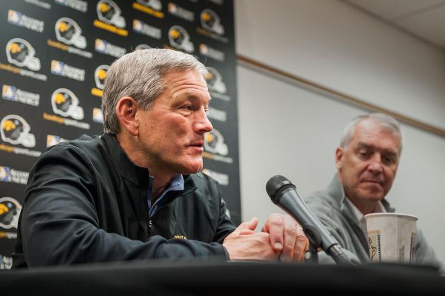 Kirk Ferentz and Gary Barta at a podium
