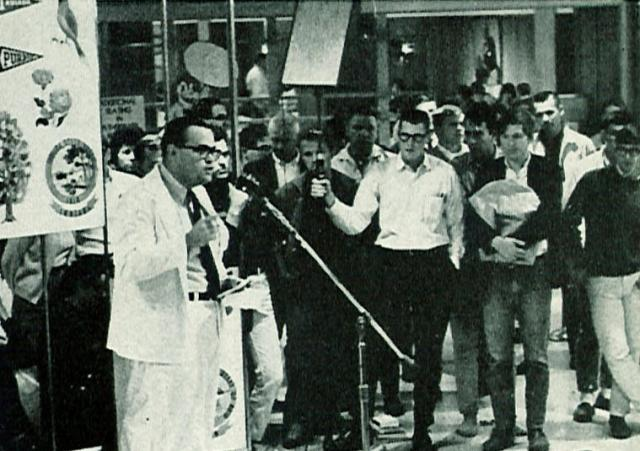 black-and white image of man addressing crowd