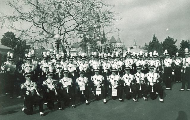 Black and white image of UI marching band posing at Disneyland in 1959.