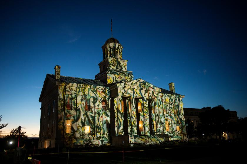 swiss light artists project imagery on old capitol at the university of iowa
