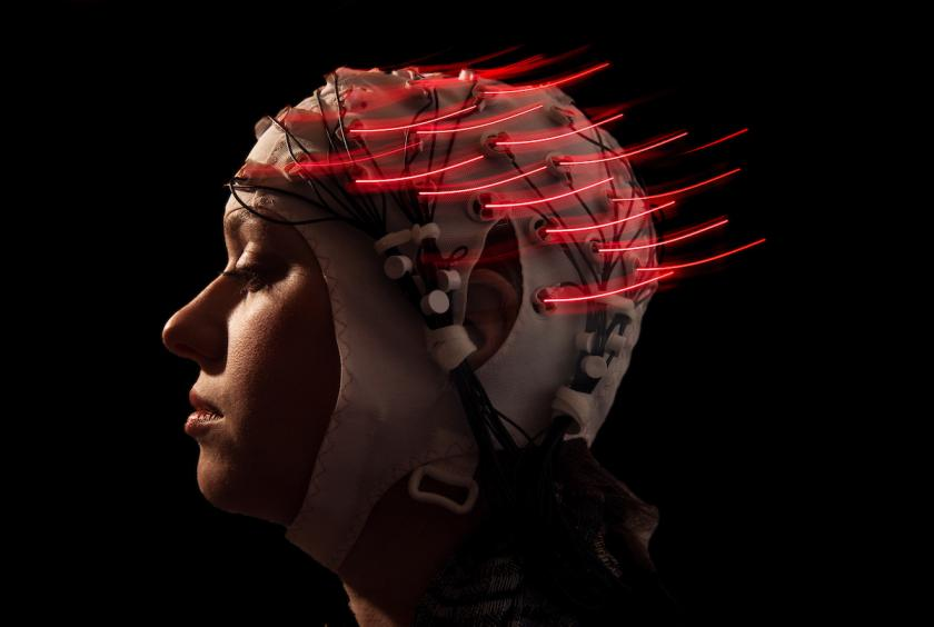 Darcy Waller gets wired up with the apparatus that measures electrical impulses in the brain that was used in the study that looked at how the brain communicates with the motor control system in the body.