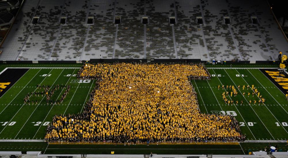 """The Class of 2023 makes a letter """"I"""" during Kickoff at Kinnick."""