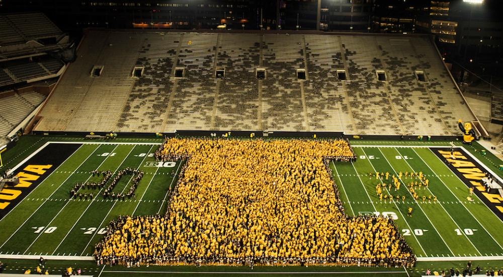 university of iowa class of 2022 forming a block I on the field at Kinnick Stadium