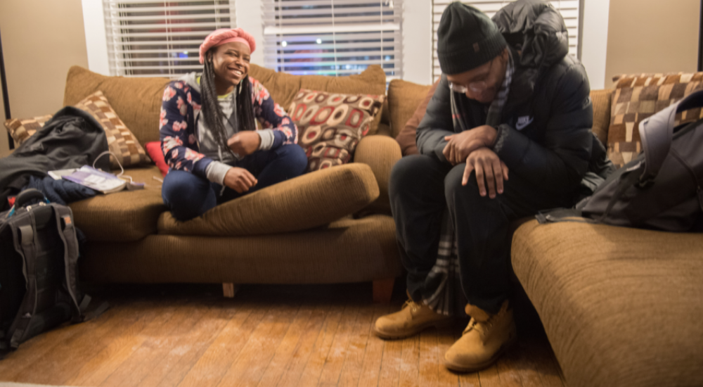 "Reanna Lewis, left, who sometimes goes by Lochemet Perach, chats and raps with Z.o.n.e. (Zones.Only.Neglect.Elevation) during a cypher at the African American Cultural Center. A cypher is an event where the ""floor is opened to anyone who wishes to rap and"