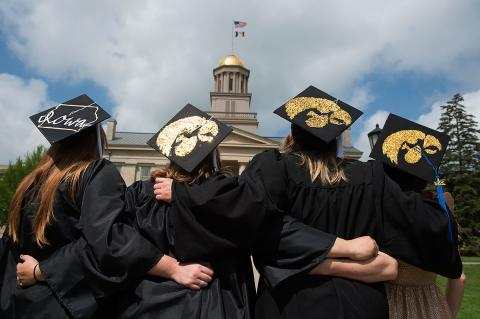 Graduates take photo in front of the Old Capitol.