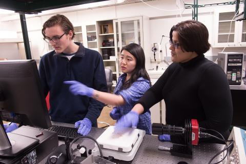 UI Engineering professor Fatima Toor (right) and her student researchers Logan Nichols, left, and Wenqi Duan, center, discuss the results of a photo they took using an infrared camera. Toor is developing an inexpensive device to test for particular types