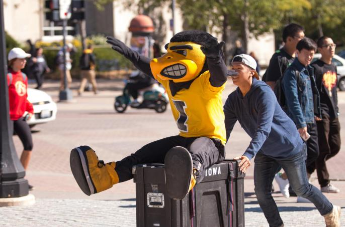 "Herky ""helps"" the Pandelirium Steel Drum Band set up their instruments on the Pentacrest for the College of Liberal Arts & Sciences' We Are Phil celebration on Wednesday, September 30."