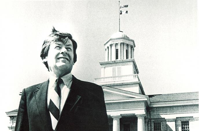 sandy boyd standing in front of old cap
