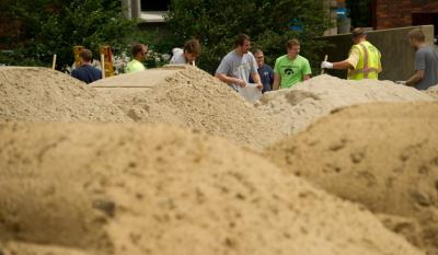 University of Iowa staff and students help fill sandbags that are being used around campus to protect against the Iowa River's rising waters. Photo by Tim Schoon