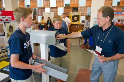 Nate Finarty and Caleb Hall from Northstar Elementary in Knoxville, Iowa, show their Rail Mail invention at the 2012 Invent Iowa event in the Seamans Center on the University of Iowa campus.