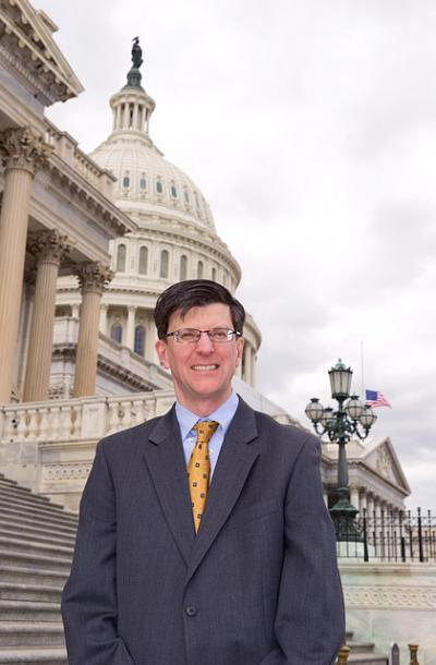UI graduate Tom Wickham stands in front of the U.S. Capitol.
