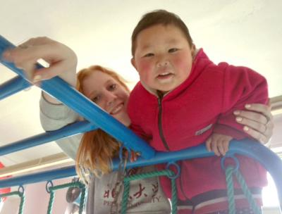Elise Prendergast with Chinese boy