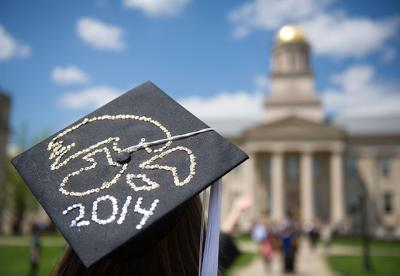 A Tigerhawk-decorated mortar board looks up at the Old Capitol.
