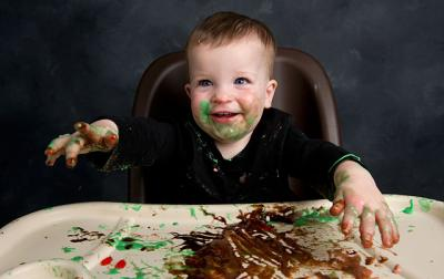A baby messy with food