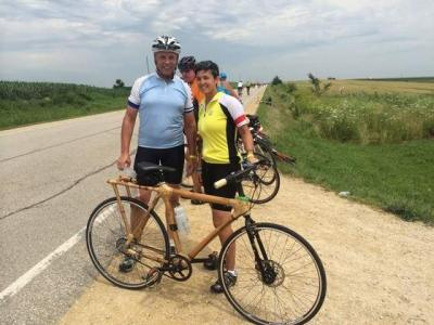 Man and Vanessa Fixmer-Oraiz stand by a bamboo bicycle during RAGBRAI