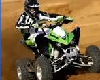 young person with helmet riding an ATV