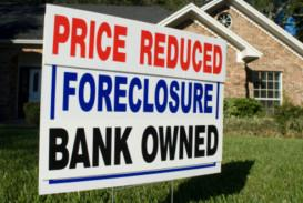 Photo of Price Reduced, Foreclosure, Bank Own sign in front of brick house