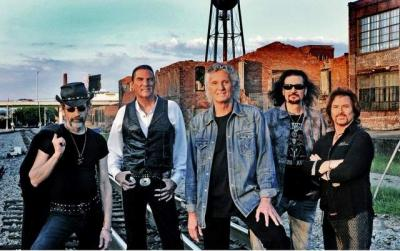 The members of the musical band Grand Funk Railroad pose for a publicity photo. The band will perform as part of the UI homecoming festivities