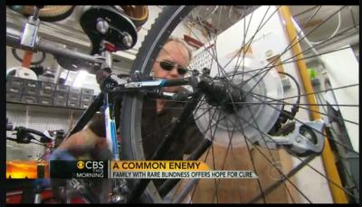 A photo of Jerry Jackson, a blind man, who is a bicycle mechanic, working on one of his bikes