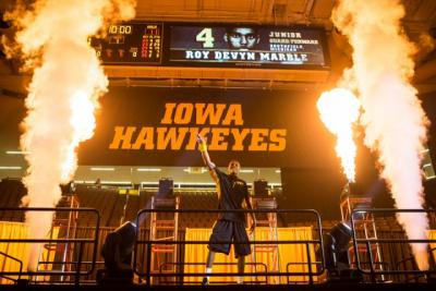 Iowa basketball player surrounded by fireworks