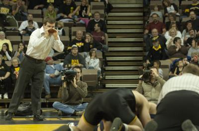 tom brands coaches at matside during a 2008 wrestling match