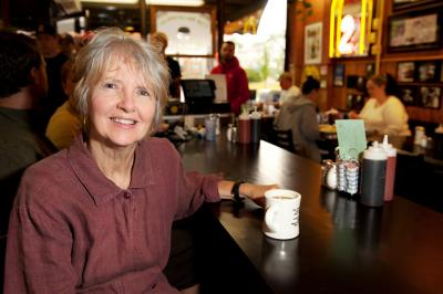 UI alumna and bookmaker Marybeth Slonneger sits at the counter of the Hamburg Inn No. 2 in Iowa City.