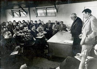 Archival photo of Robert Frost and Paul Engle with Iowa Writers' Workshop students