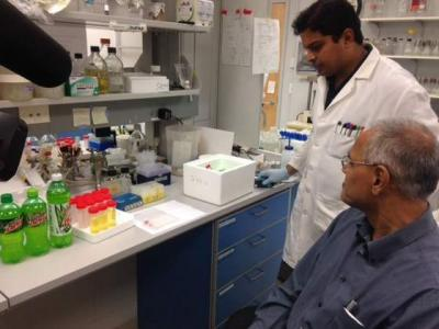 Professor Mani Subramanian and his colleagues demonstrate how caffeine dehydrogenase, when combined with a dye solution, can show the caffeine content in soft drinks.